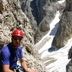 The Dolomites Mountains Climbing in Snow via ferrata